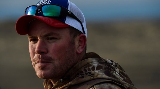 Brian Meyer is seen during a bison hunt at the American Prairie Reserve in northeastern Montana on Jan. 17, 2021. Meyer is a triple amputee who lost most of his right leg, his right hand and three fingers on his left hand to a 2011 bomb blast while he was serving as a Marine Corps bomb disposal technician in Sangin, Afghanistan, during Operation Enduring Freedom. (Thom Bridge/Independent Record via AP)