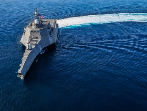 The littoral combat ship Independence sails in the Eastern Pacific on Feb. 27. Officials have no plans to ever forward-deploy Indepedence to the other side of the vast ocean, but its trimarin sisters are overseas now. (Chief Mass Communication Specialist Shannon Renfroe/Navy)