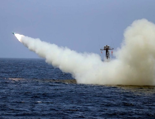 In this photo provided June 18, 2020, by the Iranian Army, a warship launches a missile during a naval exercise. (Iranian Army via AP)