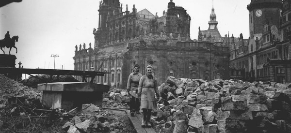 Women workers remove debris from the shell of the Hof Kirche, the Catholic cathedral in Dresden, Germany, in February 1946. (Fred Ramage/Keystone/Getty Images)