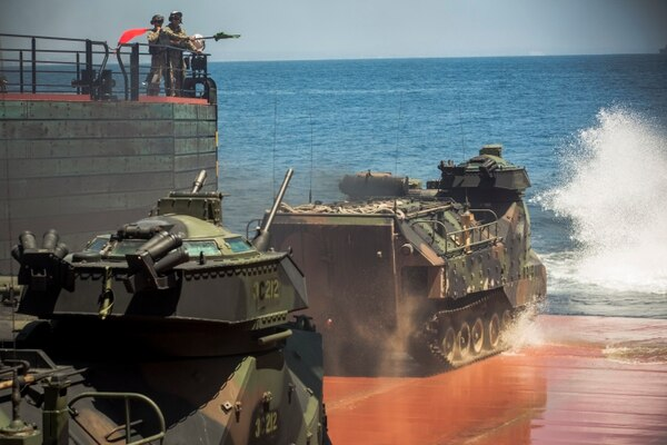 Assault Amphibious Vehicles launch into the water with foreign military leaders onboard during the USPACOM Amphibious Leaders Symposium 2016 (PALS-16) at sea, near Camp Pendleton, Calif., on July 13, 2016. PALS brings together senior leaders of allied and partner nations from the Indo-Asia Pacific region to discuss key aspects of maritime/amphibious operations, capability development, crisis response, and interoperability. Twenty-two countries, including the U.S., are participating. (U.S. Marine Corps photo by Lance Cpl. Danny Gonzalez/Released)