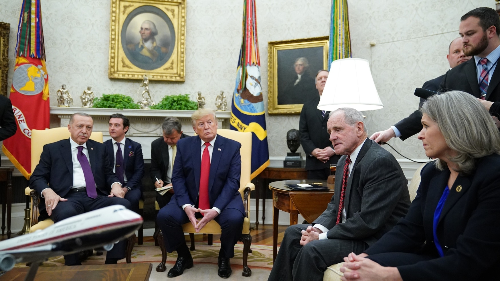 US President Donald Trump (C) and Turkey's President Recep Tayyip Erdogan (L) listen to U.S. Senate Foreign Relations Committee Jim Risch (2nd R) during a meeting in the Oval Office of the White House in Washington, DC on November 13, 2019. (MANDEL NGAN/AFP via Getty Images)