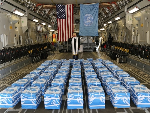 United Nations Command Chaplain U. S. Army Col. Sam Lee performs a blessing of sacrifice and remembrance on the 55 cases of remains returned by the Democratic People's Republic of Korea at Osan Air Base, Republic of Korea, on Friday. (Army Sgt. Quince Lanford)