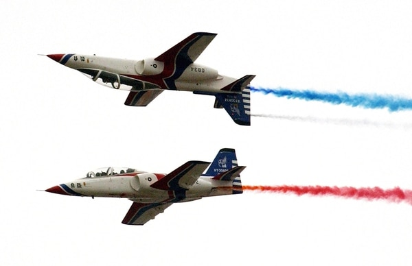 This photo shows two AT-3 aircraft performing stunts during a ceremony in a Taiwan airbase in Pingtung, 15 April 2006. The ceremony unveiled two E-2K aircraft which are expected to expand the surveillance range of radar and carry out all-weather operations to improve Taiwan's airborne early warning system capabilities against rival China which now deployed almost 800 missiles targeting the island, the defence ministry said. AFP PHOTO/PATRICK LIN