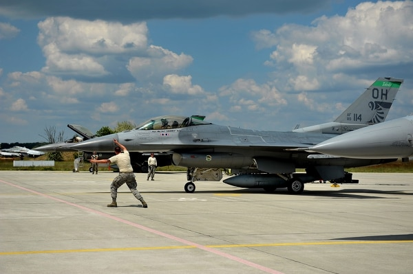 Senior Airman Bradley Asbury, an F-16 Fighting Falcon mechanic assigned to the 180th Fighter Wing of the Ohio Air National Guard, launches an aircraft for a training mission at Kecskemet Air Base, Hungary. (Senior Master Sgt. Beth Holliker/Air National Guard)