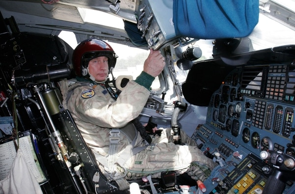 Russian President Vladimir Putin sits in the cockpit of a Tupolev Tu-160 strategic bomber on Aug. 16, 2005. (RIA Novosti/Kremlin Pool/AFP via Getty Images)