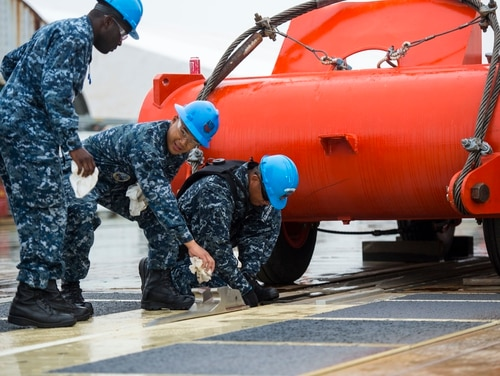 """150605-N-KK576-006 NEWPORT NEWS, Va. (June 5, 2015) — As part of a joint test group, Sailors from the future USS Gerald R. Ford (CVN 78) prepare to launch a """"dead-load"""" from the ship's Electromagnetic Aircraft Launch System (EMALS). Ford completed two successful dead-loads on the initial test day; testing will continue over the next several weeks. (U.S. Navy Photo by Mass Communication Specialist 1st Class Joshua J. Wahl/Released)"""