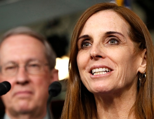 Rep. Martha McSally, R-Ariz., right, speaks during a Jan. 10, 2008, news conference with Rep. Bob Goodlatte, R-Va., on Capitol Hill in Washington. McSally called on the national GOP to