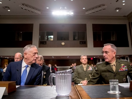 Defense Secretary Jim Mattis, left, and Joint Chiefs Chairman Gen. Joseph Dunford, right, arrive to testify on Afghanistan before the Senate Armed Services Committee on Capitol Hill in Washington, Tuesday, Oct. 3, 2017. (AP Photo/Andrew Harnik)