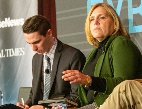 DoD's Michele Iversen speaks on a panel at CyberCon 2019. (Mike Morones/Staff)