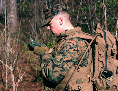 Lance Cpl. Joshua B. Gilmore sets his azimuth to the next point during a land navigation course at Marine Corps Air Station Cherry Point, North Carolina, Jan. 13, 2016. (Pfc. Nicholas P. Baird/Marine Corps)