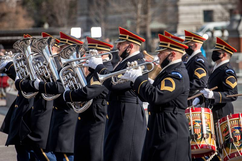 Military bands parade past President Joe Biden and Vice President Kamala Harris as they prepare to depart the Capitol following their taking the Oath of Office as the 46th president and 49th vice president of the United States in Washington on Jan. 20, 2021.