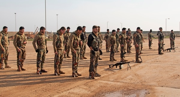 Members of Syrian partner forces form up for graduation after completing a final combat assessment in the Dayr Az Zawr Province, Syria, Dec. 6, 2018. (Sgt. Arjenis Nunez/Army)