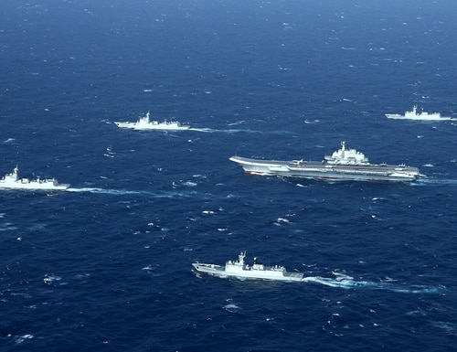 A Chinese navy formation includes the aircraft carrier Liaoning, center, during Jan. 2, 2017, military drills in the South China Sea. (STR/AFP via Getty Images)