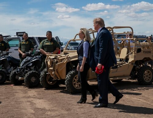 President Donald Trump walks with Homeland Security Secretary Kirstjen Nielsen as they visit a newly constructed part of a border wall with Mexico in Calexico, Calif., Friday April 5, 2019. (Jacquelyn Martin/AP)