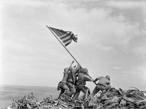 In this Feb. 23, 1945, file photo, U.S. Marines of the 28th Regiment, 5th Division, raise the American flag atop Mount Suribachi, Iwo Jima, Japan. (Joe Rosenthal/AP)