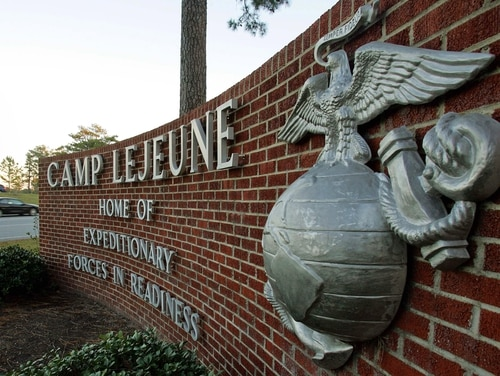 Cars enter the main gate at Camp Lejeune in Jacksonville, N.C. on Friday, Dec. 2, 2005. The sprawling military installation is the site of one of the worst drinking water contaminations in U.S. history. (AP Photo/Gerry Broome)