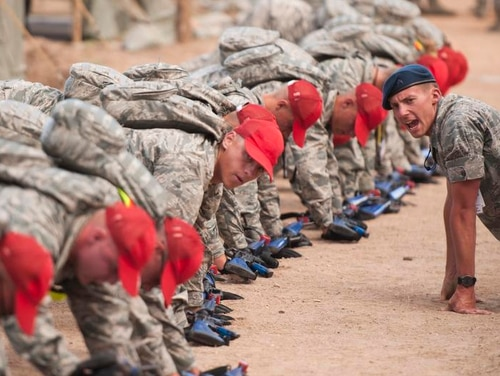 Basic cadets perform physical training at the U.S. Air Force Academy (USAFA) in Colorado Springs. A group of USAFA cadets in the Mountaineering Club put their training into practice when they saved two lost hikers on a 14,000-foot mountain last October. (Mike Morones/Staff)