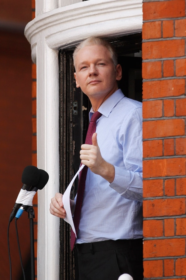 On Aug. 19, 2012, WikiLeaks founder Julian Assange gestured at a window of Ecuadorian Embassy in central London before making a statement to the media and supporters. Police in London arrested WikiLeaks founder Assange at the Ecuadorean embassy Thursday, April 11, 2019 for failing to surrender to the court in 2012, shortly after the South American nation revoked his asylum. (Sang Tan/AP)
