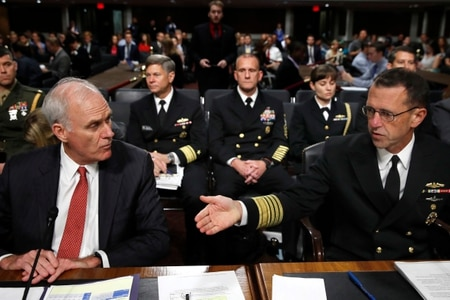 Secretary of the Navy Richard Spencer, left, listens to Chief of Naval Operations Adm. John Richardson, during a Senate Armed Services hearing, Tuesday, Sept. 19, 2017, on Capitol Hill in Washington. (AP Photo/Jacquelyn Martin)