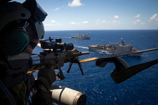 A Marine with Force Reconnaissance Platoon, 31st Marine Expeditionary Unit, sights his M1110 semi-automatic sniper system to provide security during a maritime interdiction training exercise aboard the dock landing ship Germantown in the Philippine Sea June 24. (Cpl. Karis Mattingly/Marine Corps)
