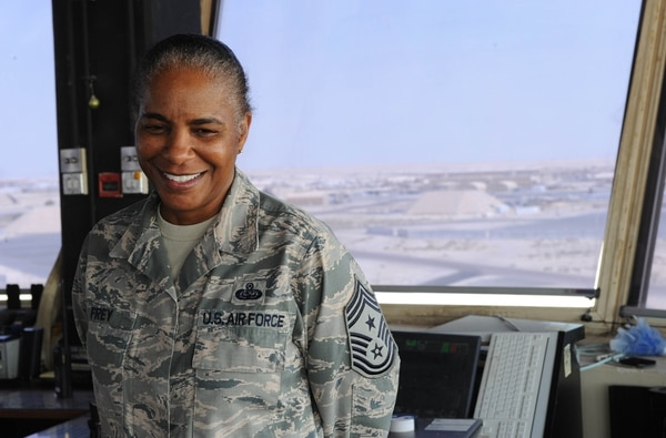 U.S. Air Force Chief Master Sgt. Shelina Frey, the command chief of Air Forces Central Command, poses for a photo in the 386th Air Expeditionary Wing air traffic control tower during her visit to an undisclosed location in Southwest Asia Aug. 20, 2013. (U.S. Air Force Photo by 1st Lt. Nathan Wallin/Released)