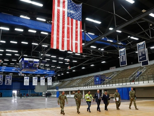 National Guard personnel join Yale New Haven Health officials at Southern Connecticut State University's Moore Field House as they prepare to survey supplies delivered by FEMA for a