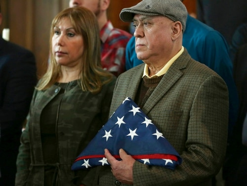 Esperanza Perez and her husband, Miguel Perez, parents of war veteran Miguel Perez Jr., stand with a handful of military veterans during a news conference Feb. 27 at the Lincoln Methodist Church in Chicago. U.S. Immigration and Customs Enforcement officials confirmed March 26 that Miguel Perez had been deported to Mexico because of a 2008 drug-trafficking conviction. (Abel Uribe/Chicago Tribune via AP)