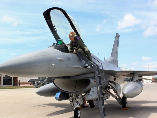 Capt. Valerie Vanderostyne with the South Dakota Air National Guard conducts a pre-flight check of the cockpit of an F-16 Fighting Falcon on July 19, 2016, at Joe Foss Field in Sioux Falls, S.D. (Regina Garcia Cano/AP)