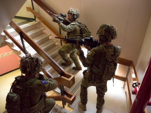 Soldiers conduct a building clearance as part of CUE17 conducted in Adelaide, South Australia. (Australian Department of Defence)