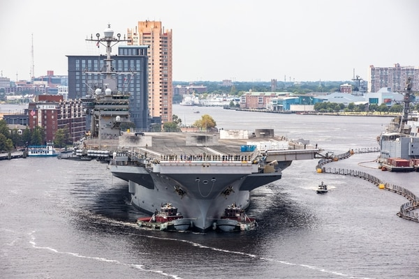The aircraft carrier USS Harry S. Truman (CVN 75) arrives at Norfolk Naval Shipyard in Portsmouth, Va., July 7, 2020, for an extended carrier incremental availability. In 2019, the Pentagon tried and failed to cancel Truman's mid-life refueling. (Shelby West/Navy)