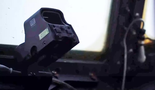 An EOTech holographic rifle sight is seen mounted in the cockpit of an AC-130W Stinger II. (Air Force)