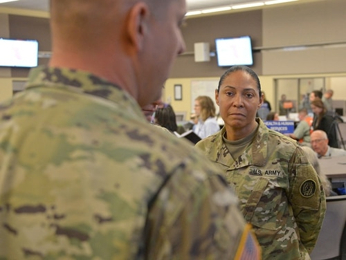 Maj. Gen. Linda L. Singh, adjutant general of Maryland, speaks to a Maryland National Guard member after a press conference at the Harford County Emergency Operations Center, Forest Hill, Md., on May 7, 2018. (Tech. Sgt. Christopher Schepers/Maryland Air National Guard)