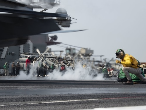 Lt. Cmdr. Justin Felgar signals an F/A-18F Super Hornet to launch from the flight deck of the aircraft carrier USS Ronald Reagan (CVN 76) on Aug. 4, 2020, in the Pacific Ocean. (MC3 Erica Bechard/Navy)