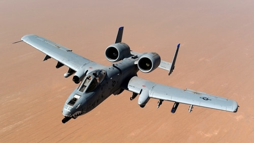 An A-10 Thunderbolt II, assigned to the 74th Fighter Squadron out of Moody Air Force Base, Georgia, returns to mission after receiving fuel over the skies of Afghanistan in 2011. (Master Sgt. William Greer/Air Force)