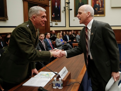 House Armed Services Committee ranking member Rep. Adam Smith, D-Wash., right, shakes hands with Marine Gen. Thomas Waldhauser before a committee hearing on March 6, 2016. Smith will take over as chairman of the committee when the new Congress convenes in January. (Carolyn Kaster/AP)
