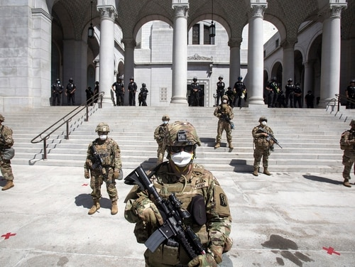 Members of California National Guard stand guard outside the City Hall, Sunday, May 31, 2020, in Los Angeles. (Ringo H.W. Chiu/AP)