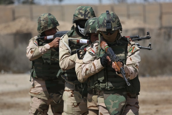 TAJI, IRAQ - APRIL 12: Iraqi Army recruits train under U.S. supervision at a military base on April 12, 2015 in Taji, Iraq. Members of the U.S. Army's 5-73 CAV, 3BCT, 82nd Airborne Division are teaching soldiers from the newly-formed 15th Division of the Iraqi Army, as the Iraqi government launches offensives to try to recover territory lost to ISIS last year. U.S. forces, currently operating in 5 large bases throught Iraq, are training thousands of Iraqi Army combat troops, trying to rebuild a force they had origninally trained before the U.S. withdrawal from Iraq in 2010. (Photo by John Moore/Getty Images)
