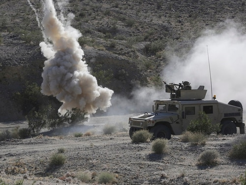 Soldiers with the 155th Brigade Combat Team react to a simulated ambush during a rotation at the National Training Center at Fort Irwin, Calif., June 5, 2017. (Spc. Daniel Parrott/Army)