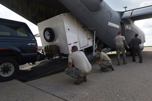 Airmen load a Joint Incident Site Communications Capability trailer onto a C-130J Hercules to help with Hurricane Harvey relief efforts. Eight more are headed to Puerto Rico in the aftermath of Hurricane Maria.. (Master Sgt. Matt Schwartz/Air Force)