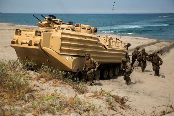 Marines exit an Amphibious Assault Vehicle carrying Philippine and U.S. Marines during a bilateral amphibious landing on North Beach at the Naval Education Training Center on April 21, 2015, as part of exercise Balikatan 2015. (Cpl. Matthew J. Bragg/Marine Corps)
