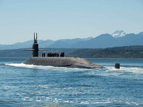 Four submariners are accused of having group sex with a child in the barracks of a Washington State base last year, according to Navy officials and charge sheets. Two are assigned to the blue crew of the submarine Nebraska, shown here this summer. (U.S. Navy photo)