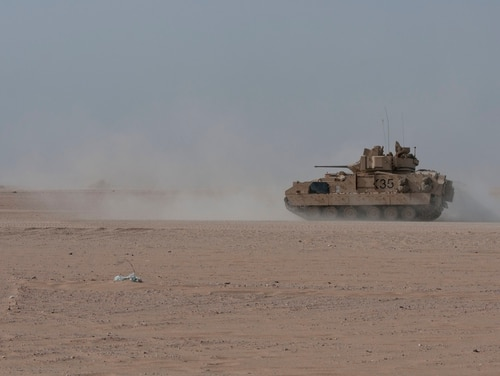 A Bradley Fighting Vehicle charges forward during a training exercise on Udari Range Complex near Camp Buehring, Kuwait, Oct. 17, 2017. (Sgt. David L. Nye/Army)
