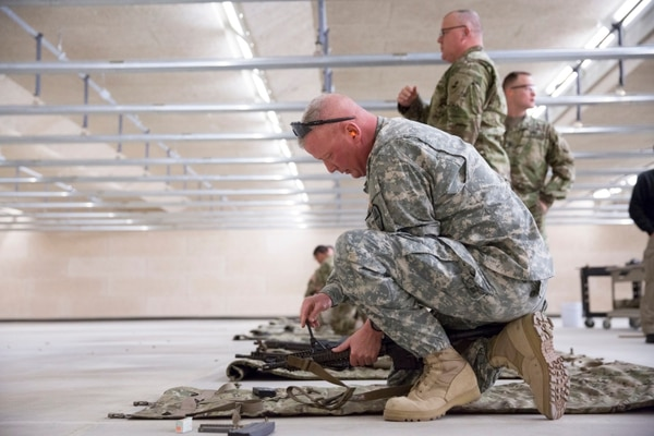 Command Sergeant Major Travis Cherry adjusts his iron sights during a session at an indoor range at Fort A.P. Hill. Sergeants Major from around the Army met with members of the Asymmetric Warfare Group and discussed Adaptive Soldier Leader Training and Education (ASLTE) on Wednesday, February 10, 2016. (Mike Morones/Staff)