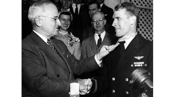 Lt. j.g. Thomas Hudner receives congratulations from President Truman on April 13, 1955, after Hudner was presented with the Medal of Honor in ceremonies at the White House. (Navy)