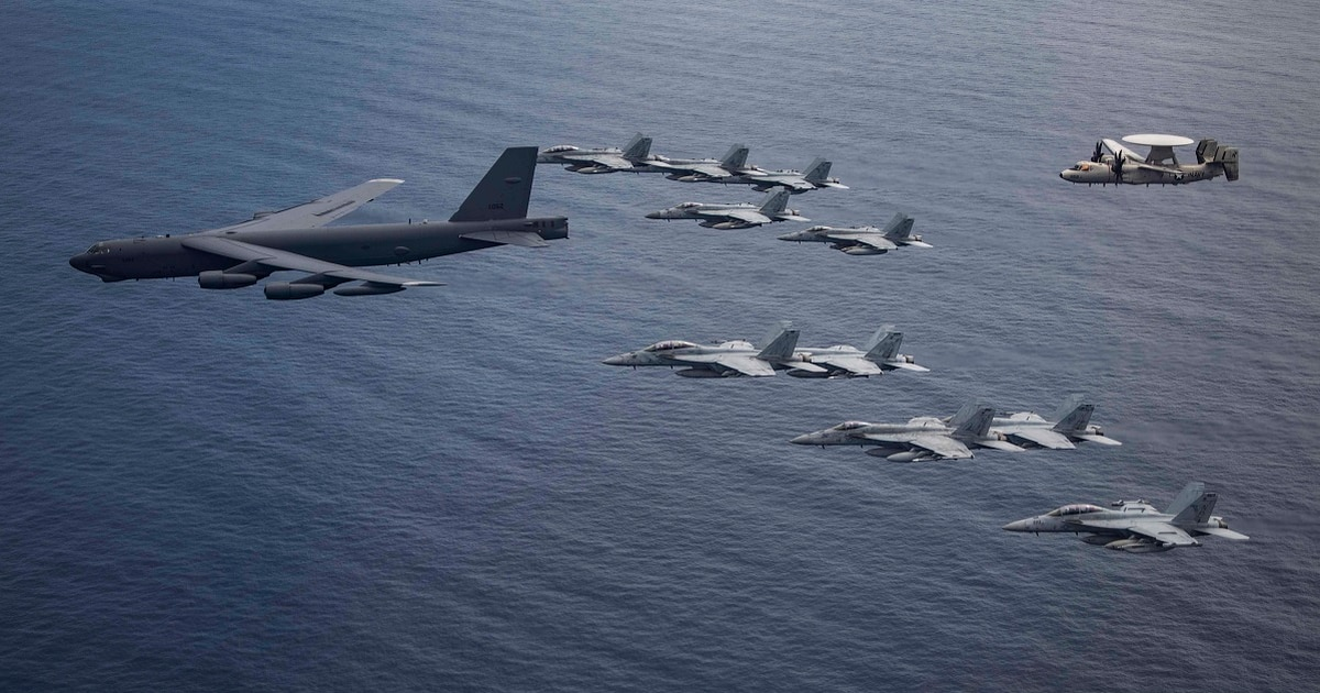 Two US aircraft carriers are operating in the South China Sea; Air Force B-52 joins them