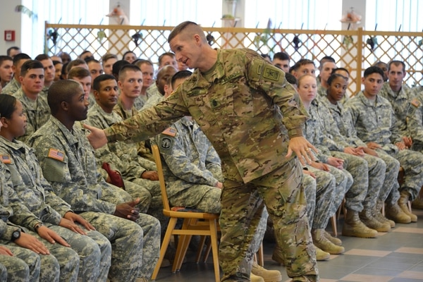 Sgt. Maj. of the Army Daniel A. Dailey (standing) conducts Leader Professional Development with Warrior Leader Course students at the at the 7th Army Noncommissioned Officer Academy, Grafenwoehr, Germany, Sept. 9, 2015. This is the SMA's first visit to U.S. Army Europe since taking the position. (U.S. Army video by Visual Information Specialist Gertrud Zach/released)
