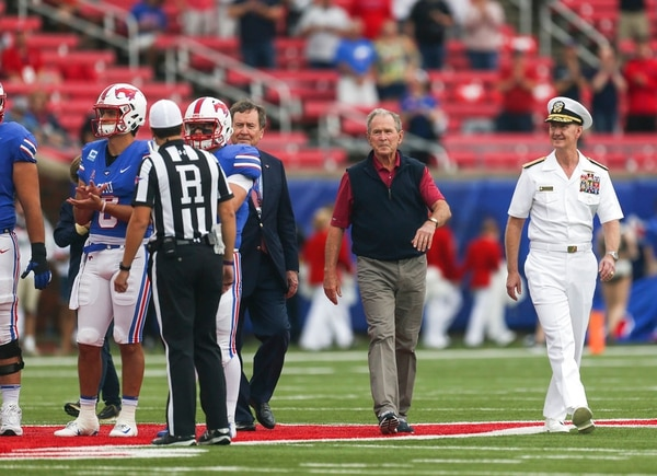 Former President George W. Bush makes his way onto the field for the coin toss before the Saturday game between Navy and SMU at Gerald J. Ford Stadium in Dallas. (Ryan Michalesko/The Dallas Morning News via AP)