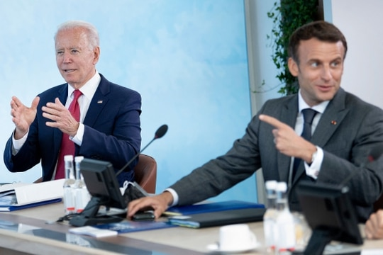 U.S. President Joe Biden, left, listens as French President Emmanuel Macron speaks at a working session during the G-7 summit in Carbis Bay, Cornwall, on June 12, 2021. (Brendan Smialowski/AFP via Getty Images)