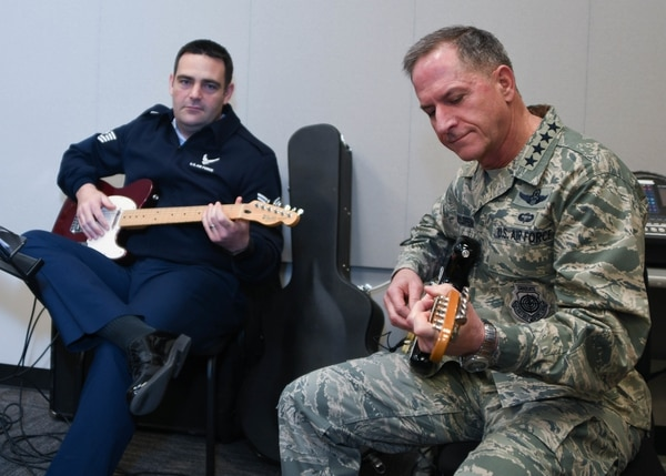 Air Force Chief of Staff Gen. Dave Goldfein and Tech. Sgt. Christopher Dunning, member of the Air National Guard Band of the Southwest, also known as 531st Air Force Band, play guitar during an impromptu jam session at Naval Air Station Fort Worth Joint Reserve Base, Texas, Jan. 29, 2017. (Senior Airman De'Jon Williams/Air National Guard)